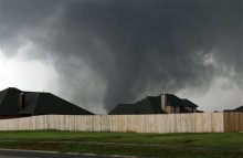 A tornado moves past homes in Moore on Monday (AP Photo/Alonzo Adams)
