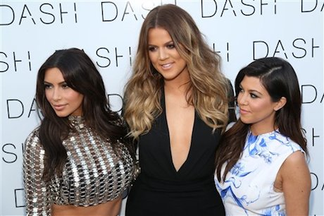 Kim Kardashian, Khloe Kardashian and Kourtney Kardashian attend the opening of their boutique Dash -- seriously, that's its name -- in Miami Beach, Florida, in March. (Photo by Omar Vega/Invision/AP)