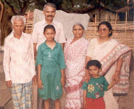 From left to right, Father, Neha, Isaac (back), Mother, Nikhil, Rekha (front) Outside village home