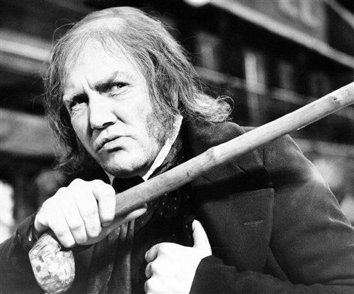 "British actor Albert Finney waves his cane while playing the title role in ""Scrooge,"" at Shepperton Studios, near London, Jan. 15, 1970. (AP Photo/R. Dear)"