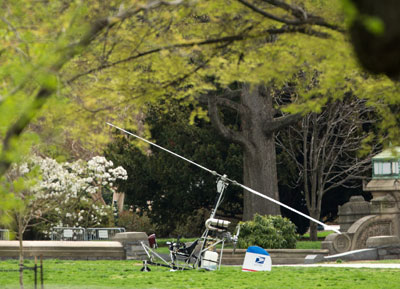 A police device rolls toward a copter device, right, that landed on the West Front of the Capitol in Washington, Wednesday. (AP Photo/Lauren Victoria Burke)