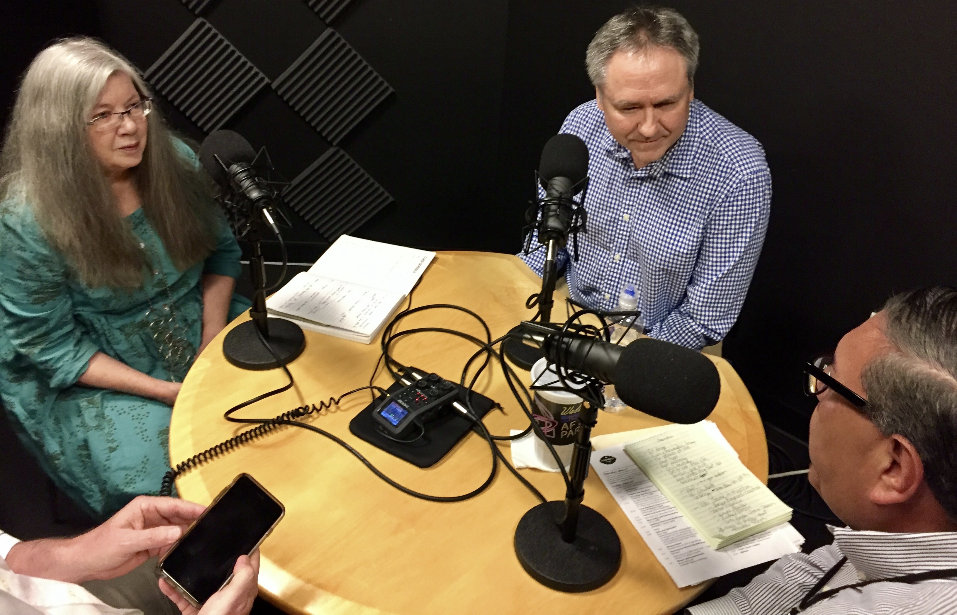 From left, Alison Cook, J.C. Reid and Greg Morago film the third episode of the Houston Chronicle's BBQ podcast. (Photo by Kristen Hare/Poynter)