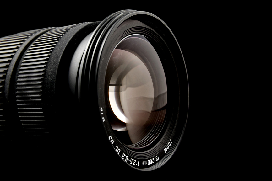Closeup of camera lens over black background
