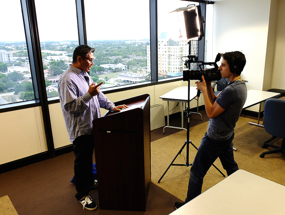 "South Florida Sun Sentinel columnist Daniel Vasquez and photojournalist Dylan Bouscher tape an episode of ""Dan Won't Shut Up!"" where Vasquez takes a lighter look at the hot topics of the day and offers his own take. The series is part of the"