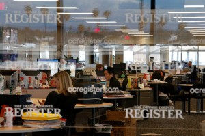 The Orange County Register's new owner thought the way to turn the paper around is through better reporting to lure new and former readers to a revived product. He has since stepped away from managing the paper. (AP Photo/Jae C. Hong)