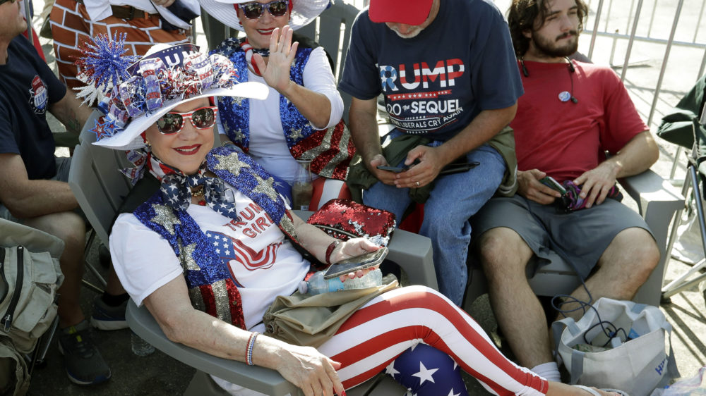 Supporters of President Donald Trump wait in line hours before the arena doors open for a campaign rally Tuesday in Orlando, Florida. (AP Photo/John Raoux)