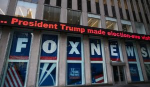 A headline about President Donald Trump is shown outside Fox News studios in 2018.  (AP Photo/Mark Lennihan)