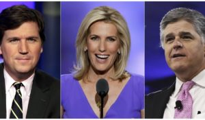 Fox News hosts Tucker Carlson, Laura Ingraham and Sean Hannity. (AP Photo)