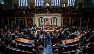House members vote on Thursday on a resolution on impeachment procedure to move forward into the next phase of the impeachment inquiry into President Donald Trump. (AP Photo/Andrew Harnik)
