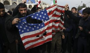 Protesters burn a U.S. flag during a demonstration over the U.S. airstrike in Iraq that killed Iranian Revolutionary Guard Gen. Qassem Soleimani. (AP Photo/Vahid Salemi)