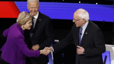 Democratic presidential candidates Elizabeth Warren, left, and Bernie Sanders, right, greet each other as Joe Biden, center, watches before Tuesday night's Democratic presidential debate. (AP Photo/Patrick Semansky)