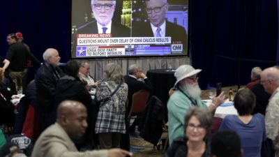 Supporters of Democratic presidential candidate Sen. Amy Klobuchar, wait for the caucus results to be released Monday night. (AP Photo/Nati Harnik)