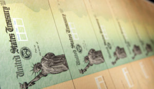 Blank stimulus checks are seen on an idle press at the Philadelphia Regional Financial Center, which disburses payments on behalf of federal agencies, in Philadelphia, Thursday, May 8, 2008. (AP Photo/Matt Rourke)