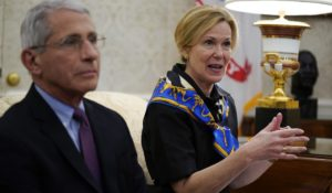 White House coronavirus response coordinator Dr. Deborah Birx, right, speaks as Director of the National Institute of Allergy and Infectious Diseases Dr. Anthony Fauci listens at the White House last month. (AP Photo/Evan Vucci)