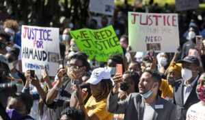People at a rally last week in Brunswick, Georgia to protest the shooting of Ahmaud Arbery. (AP Photo/John Bazemore)