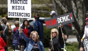Protesters rally in Augusta, Maine, on Saturday. (AP Photo/Robert F. Bukaty)