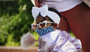 A child wearing a mask and enjoying the weather at Domino Park in Brooklyn during the coronavirus pandemic on May 16, 2020. (John Nacion/STAR MAX/IPx)