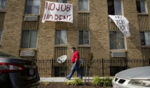 """Signs that read """"No Job No Rent"""" hang from the windows of an apartment building during the coronavirus pandemic in Northwest Washington on May 20. As protections end, many renters will face eviction. (AP Photo/Andrew Harnik, File)"""