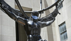 The famed sculpture of Atlas at Rockefeller Center is covered with a face mask to coincide with New York City entering phase two of reopening. (Diane Bondareff/AP Images for Tishman Speyer)