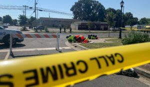 Police tape is seen near the scene of a shooting in Charlotte on early Monday that resulted in two deaths and several more people wounded or injured. (AP Photo/Sarah Blake Morgan)