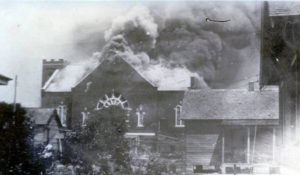 A church burned in a Black neighborhood in Tulsa, Oklahoma, in 1921. (Courtesy: CBS News)