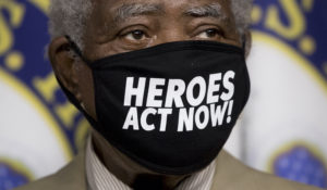 """Rep. Danny Davis, D-Ill., wears a mask that reads """"Heroes Act Now"""" as he appears at a news conference on Capitol Hill in Washington, Friday, July 24, on the extension of federal unemployment benefits. (AP Photo/Andrew Harnik)"""