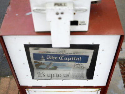 A copy of the day's Capital Gazette newspaper rests in a newsstand, Monday, April 15, 2019, in Annapolis, Maryland. (AP Photo/Patrick Semansky)