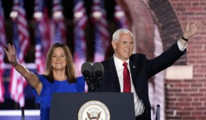 Vice President Mike Pence arrives with his wife Karen Pence to speak on the third day of the Republican National Convention on Wednesday. (AP Photo/Andrew Harnik)