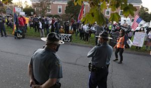 Housing activists gather in front of Gov. Charlie Baker's house, Wednesday, Oct. 14, 2020, in Swampscott, Mass. The protesters were calling on the governor to support more robust protections against evictions and foreclosures during the ongoing coronavirus pandemic. (AP Photo/Michael Dwyer)