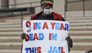 Al Porter protests at the Cuyahoga County jail for the release of incarcerated people in May in Cleveland. (AP Photo/Tony Dejak)