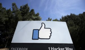 In this file photo, the thumbs-up Like logo is shown on a sign at Facebook headquarters in Menlo Park, Calif.  (AP Photo/Jeff Chiu, File)