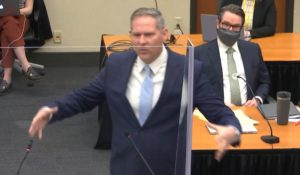 In this image from video, prosecutor Steve Schleicher gives closing arguments while defense attorney Eric Nelson, right, listens in the trial of former Minneapolis police Officer Derek Chauvin in Minneapolis. (Court TV via AP, Pool)