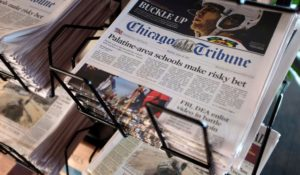 A copy of the Chicago Tribune from a 2016 file photo. (AP Photo/Kiichiro Sato, File)