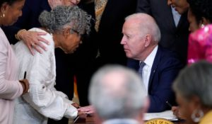 President Joe Biden speaks with Opal Lee after he signed the Juneteenth National Independence Day Act on Thursday. (AP Photo/Evan Vucci)