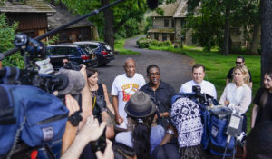 Bill Cosby, center, and spokesperson Andrew Wyatt, right, approach members of the media gathered outside the home of the entertainer in Elkins Park, Pa., Wednesday, June 30,2021. Pennsylvania's highest court has overturned comedian Bill Cosby's sex assault conviction. The court said Wednesday, that they found an agreement with a previous prosecutor prevented him from being charged in the case. The 83-year-old Cosby had served more than two years at the state prison near Philadelphia and was released. (AP Photo/Matt Slocum)