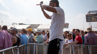 Sameer Rao covering a music festival in 2019 for the Baltimore Sun. (Image by Ulysses Muñoz)