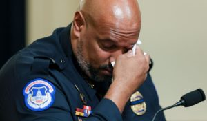 U.S. Capitol Police Sgt. Harry Dunn wipes his eye as he testifies during the House select committee hearing on the Jan. 6 attack on Capitol Hill in Washington on Tuesday. (Oliver Contreras/The New York Times via AP, Pool)