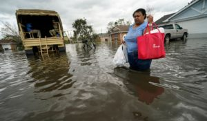 Jerilyn Collins returns to her destroyed home with the assistance of a Louisiana National Guard high-water vehicle to retrieve medicine and a few possessions, after she evacuated from rising floodwater in the aftermath of Hurricane Ida in LaPlace, La. on Monday. (AP Photo/Gerald Herbert)