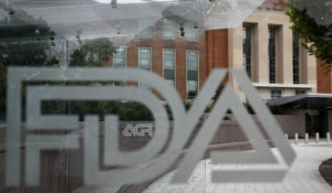 Food and Drug Administration signage is seen through a bus stop at the U.S. Department of Health and Human Services, Thursday, Aug. 2, 2018, in Silver Spring, Md., on the FDA grounds. (AP Photo/Jacquelyn Martin)